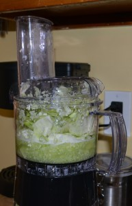 Add chopped cabbage and water to food processor.