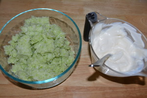 Mix cabbage and mayonnaise and sour cream mixture until thoroughly combined.