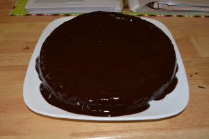 Push glaze around the cake slowly covering the top and sides.