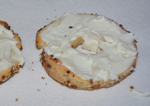 Everything bagels lightly toasted and layered with low fat cream cheese.