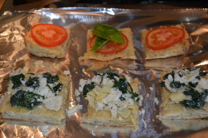 Toast focaccia for 15 minutes at 350 degrees, then top with caprese or spinach artichoke toppings.
