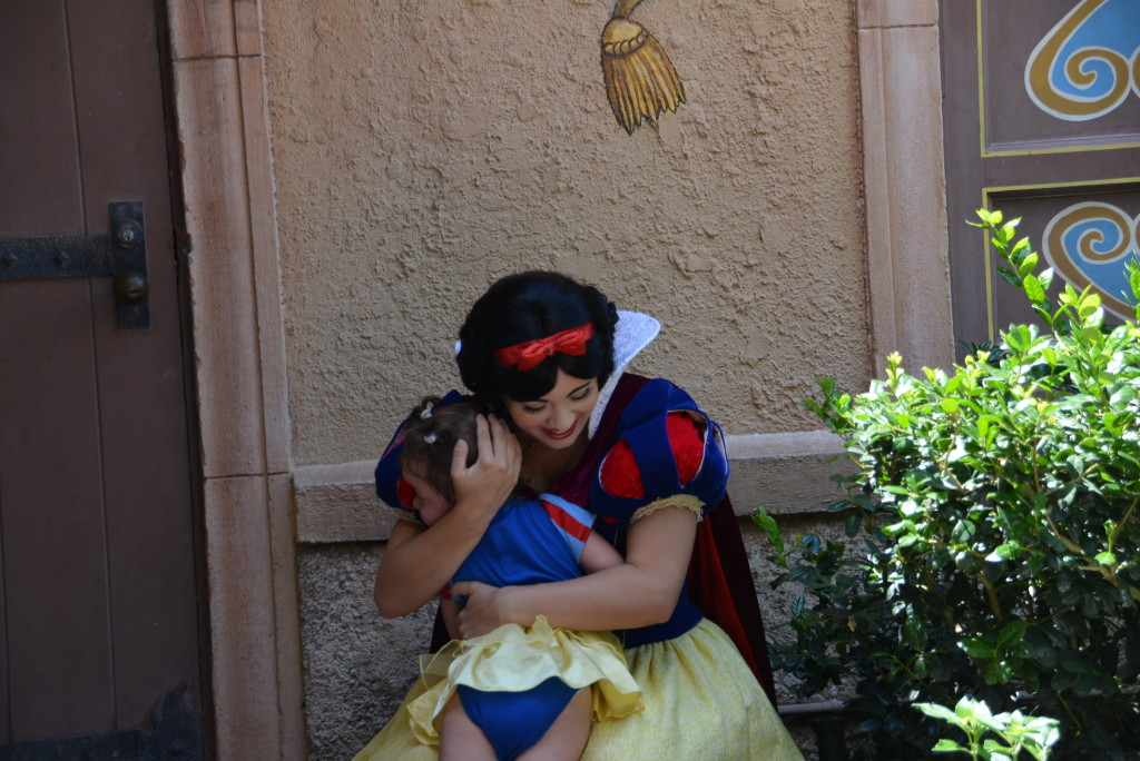 Our little Snow White giving her favorite princess some love!