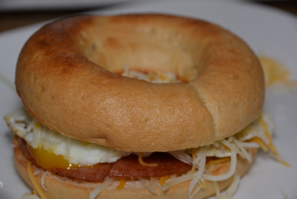 Porkroll, egg, and cheese on a toasted Schar bagel.