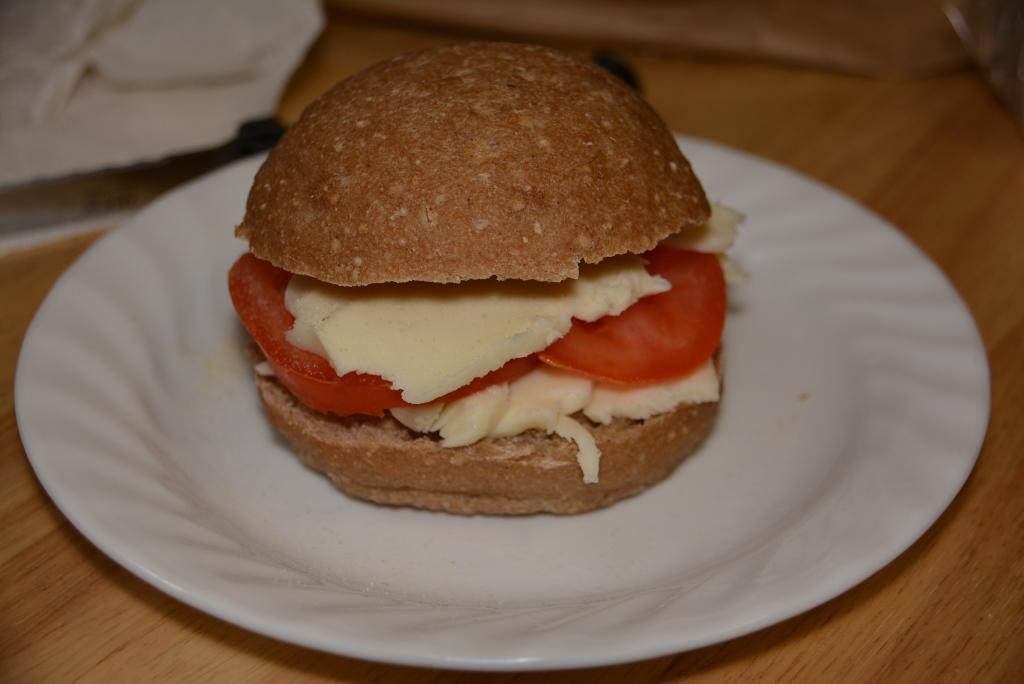 Fresh Mozzarella, Sliced Tomatoes, And A Gluten Free Sourdough Roll