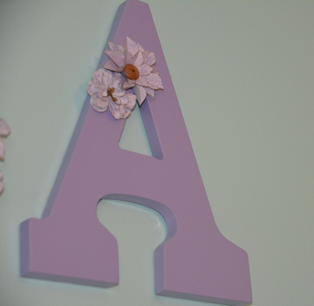 Lilac letters with floral accents.