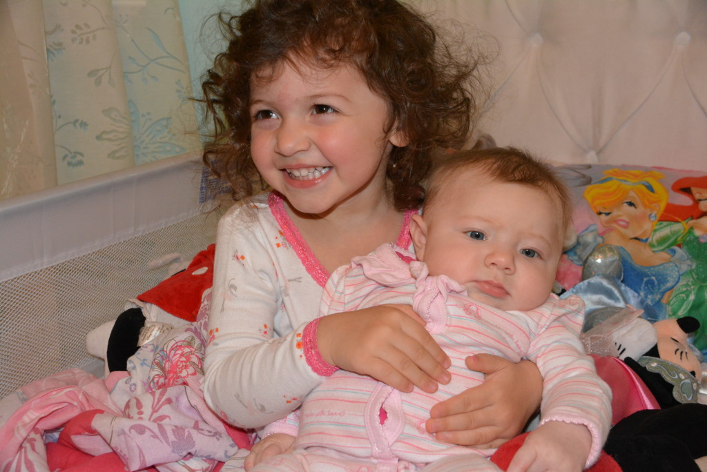 These two little girls love each other so much already. Watching our toddler share her world, and her germs unfortunately, with her little sister has warmed our hearts and we can't believe we're so lucky to be blessed with two such sweet girls!